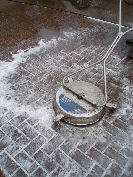 Rotary headed cleaner in action+ driveway cleaning fluid